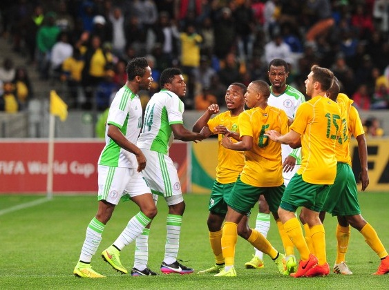 Super Eagles Forward Gbolahan Salami in a Heated Scuffle With Bafana Bafana Players at the Cape Town Stadium.