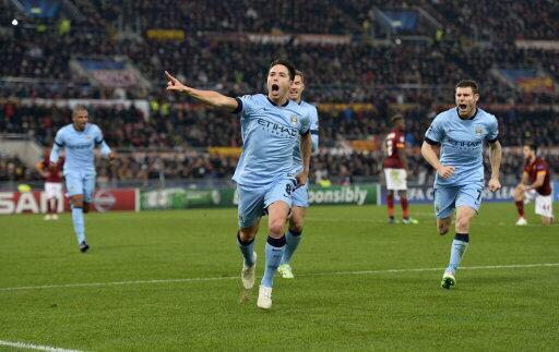 Samir Nasri Celebrates City's First at the Stadio Olimpicio on Match Day 6. Image: Getty.