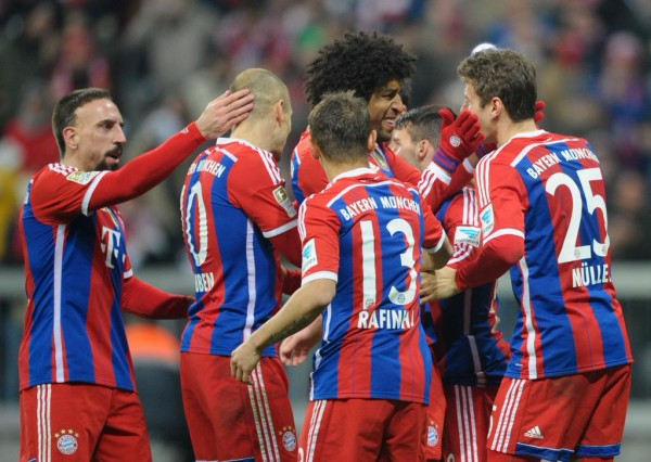 Thomas Muller Celebrates With His Team-Mates after Scoring Bayern's Second Goal Against Freiburg. Image: FC Bayern via Getty.