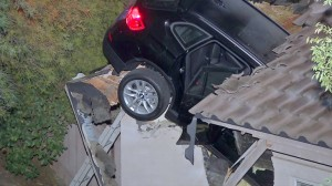 Freak Accident: SUV Crashes Into Roof Of California Garage