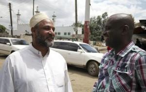 Wanguthi, a Muslim leader, talks to a man near a mosque in Muslim-dominated Eastleigh neighbourhood in Kenya's capital Nairobi