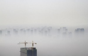 A building under construction is seen amidst smog on a polluted day in Shenyang