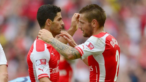 Mikel Arteta and Mathieu Debuchy Out for Three Months With Injuries. Image: Carl Court/ AFP/Getty.