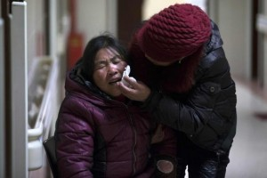 A woman cries at a hospital after a stampede occurred during a New Year's celebration on the Bund, central Shanghai