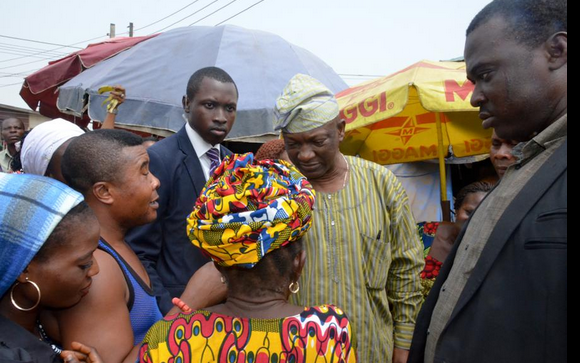 Agbaje answering questions from market women at Ogudu market
