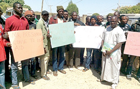 SOME OF THE DISMISSED SOLDIERS DURING THEIR PROTEST IN JOS … FRIDAY. (PHOTO: GUARDIAN NEWSPAPER)