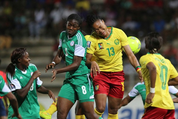 Assisat Oshoala Vies for an Aerial Ball Against a South African Opponent During the AWC in Namibia. Image: Caf via BackPagePix.