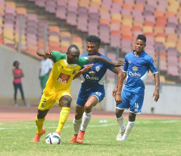 Kano Pillars' Isaac Loute Fends Off Dolphins Ifeanyi Egwim's Challenge During the 2015 Super 4 Pre-Season in Abuja. Image: LMC
