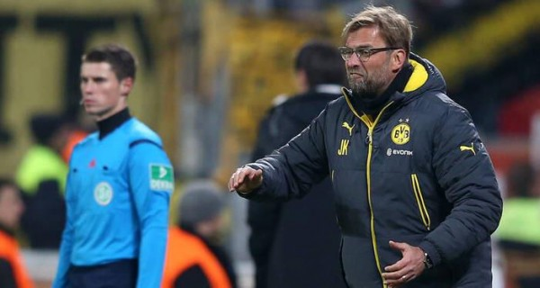 Jurgen Klopp Passes Instruction to His Wards During a Game at Bayer Leverkusen. Image: Getty.