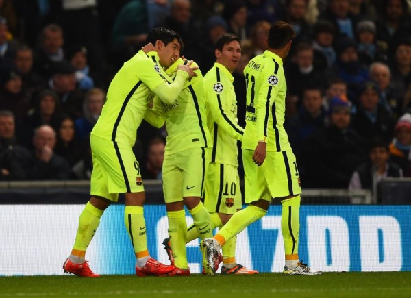 Luis Suarez Celebrates With Team-Mates After Scoring His First Goal at the Etihad Stadium. Image: Getty.