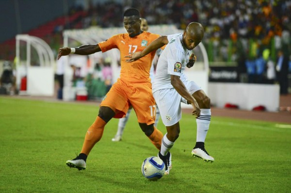 Serge Aurier Tackles Yacine Brahimi During an Afcon 2015 Quarter-Finals Clash Between Cote d'Ivoire and Algeria. Image: Caf via BackPagePix.