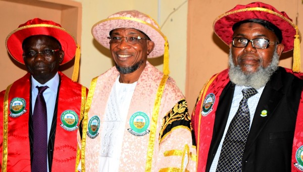 Osun State Governor, Rauf Aregbesola (middle); Pro-Chancellor and Chairman of Council Osun State University, Osogbo, Professor Gabriel Adesiyan Olawoyin (2nd left) and Vice – Chancellor, Professor Adekunle Bashiru Okesina (right) during the 3rd Convocation Ceremony at Osun State University, Osogbo on Saturday 29/03/2014
