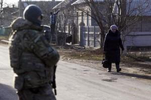 A local resident walks along a street in the settlement of Velyka Novosilka