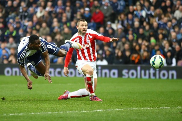 Brown Ideye Scores a Diving Header Against Stoke City in a Premier League Game. Image: Getty.