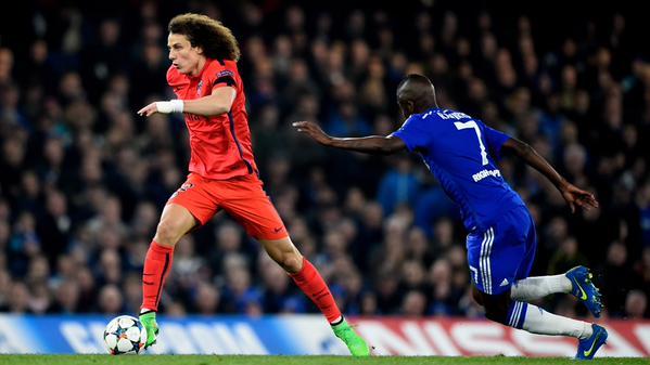 David Luiz Runs With the Ball Against his Brazil Team-Mate Ramirez. Image: Getty.