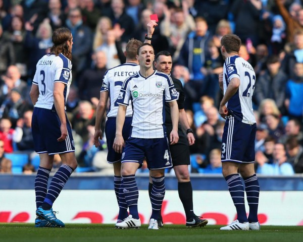 Gareth McAuley Wrong Sent Off By Referee Nick Swabrick During a Premier League Game at the Etihad Stadium. Image: Getty.