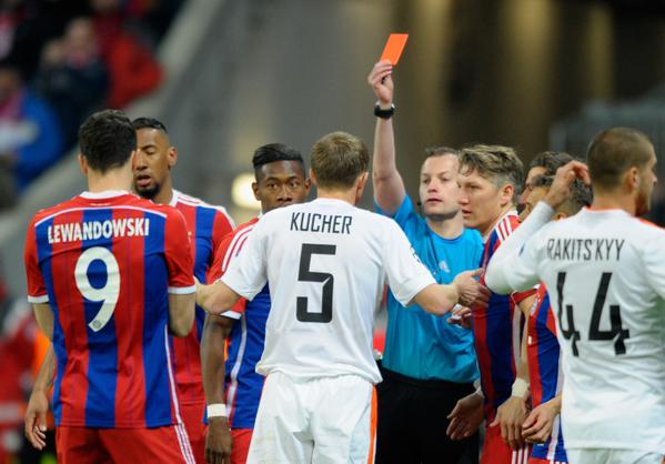 Oleksandr Sees Red for a Needless Third-Minute Tackle on a Rampaging Mario Gotze. Image: AFP/Getty.