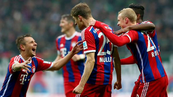 Thomas Muller Celebrate With Team-Mates After Opening Scores for Bayern at Werder Bremen. Image: Getty.