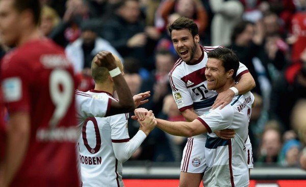 Xabi Alonso Celebrates With Team-Mates after His Beautifully Taken Free-Kick Pulled the Bavarians Back on Level Terms. Image: Getty.