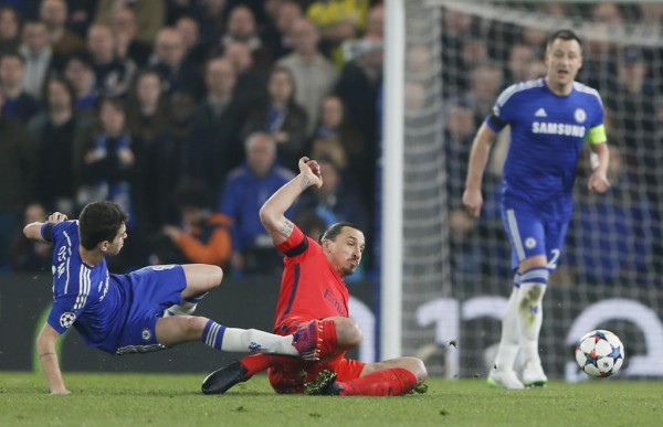 Oscar and Ibrahimovic in a 50-50 Challenge Which Earned the Latter a Red Card. Image: AFP/Getty.