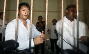 File photo of Australian Andrew Chan and Myuran Sukumaran waiting in a temporary cell for their appeal hearing in Denpasar District Court in Indonesia's resort island of Bali