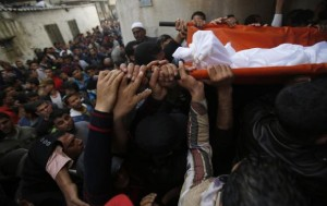 Mourners carry the body of Palestinian fisherman Tawfiq Abu Reyala, 34, whom medics said was killed by Israeli navy, during his funeral at Shatti refugee camp in Gaza City