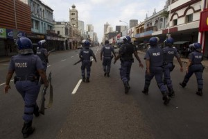 Police clear the streets in an attempt to quell rioting and looting caused from anti-foreigner violence in Durban