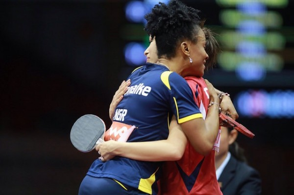 Olufunke Embraces Safa Saidana of Tunisia after Her Final Round-Robin Group Win on Monday. Image: Remy Gros for ITTF.