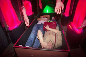 "Pic shows: A theme park let punter lie in a wooden coffin in a mortuory where ghoulish ride attendants push him into a furnace. A spooky new theme park attraction where punters can experience being cremated has been flooded with crowds wanting to experience the after life. The wacky 4D Death Simulator at the Window Of The World theme park in Shenzhen in Southern China`s Guangdong Province has opened in time for Halloween and let's punters lie in a wooden coffin in a mortuary where ghoulish ride attendants push them into a furnace. Once inside, the temperature rises to a sweltering 40 degrees Celsius using heat fans. Thrilled fan Ting Shen, 22, said: ""I went on it and it's amazing. ""You really feel like you're being burnt alive. ""I feel like I died and came back. ""I'm definitely doing that again."" A spokesman for the park said: ""It's good fun and completely safe. ""The customers can wander around the morgue first and then get to fell how it would be if they were cremated. ""It's already proved massively popular and we expect it to be more so over the Halloween period. ""People have a morbid fascination with death and the after-life and this is a good way of experiencing both."" But the attraction has so far only appealed to younger crowds. Mum Yue Wan Ho, 43, said: ""I went into the morgue bit with my kids who couldn't wait to get inside the coffin. ""But I think it's all just a little bit too weird for me. ""And definitely too scary. ""I think I'll wait until my time is really up before pretending it is."" (ends)"
