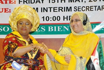FORMER PRESIDENT, AFRICAN FIRST LADIES PEACE MISSION (AFLPM), DAME PATIENCE JONATHAN (LEFT), HANDING OVER TO JADIYA HAMDI MOHAMED, FIRST LADY OF SAHRAWI ARAB DEMOCRATIC REPUBLIC, WHO REPRESENTED HER SUCCESSOR, SIA KOROMA OF SIERRA LEONE AT THE EMERGENCY 8TH SUMMIT OF THE AFLPM IN ABUJA, YESTERDAY. PHOTO: NAN