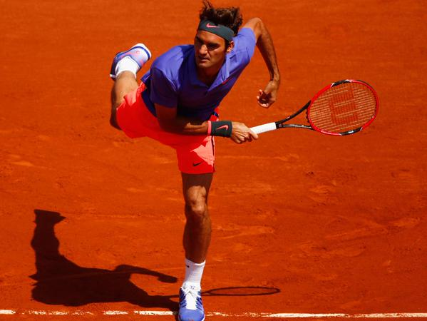 Roger Federer Serves an Ace Against Alejandro Falia During His 2015 Roland Garros Opening Game. Image: Getty.