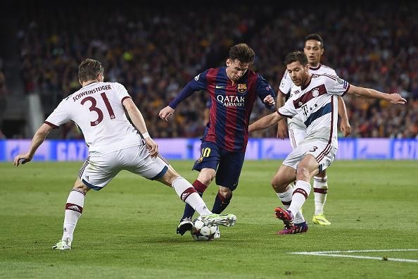 Lionel Messi Tires to Wrrigle His Way Through Bayern Defence at the Camp Nou. Image: Getty/AFP.