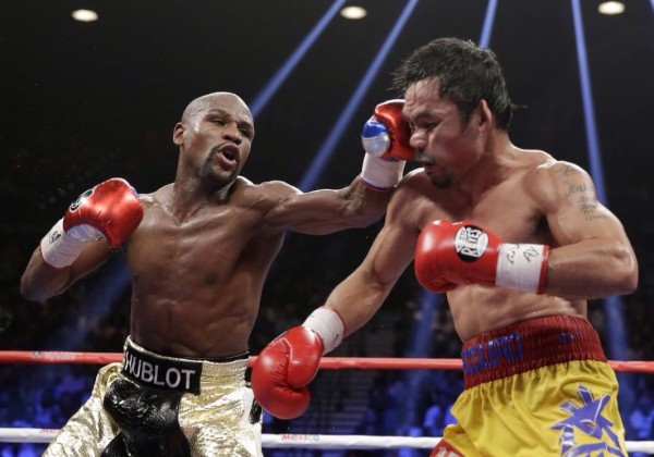 Floyd Mayweather Lands a Left Hook on Manny Pacquaio During Their Super- Fight in LA.