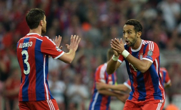 Mehdi Benatia and Xabi Alonso After the Former's Opener against Barca. Image: AFP/ Getty.