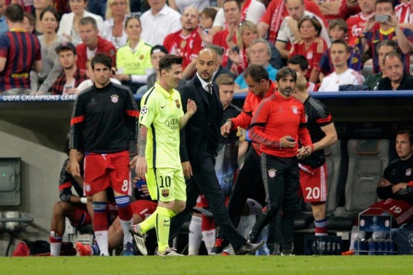 Pep Guardiola and Lionel Messi Chatting on Their Way Back to the Dressing Room at the Allianz Arena. Image: AFP/Getty.