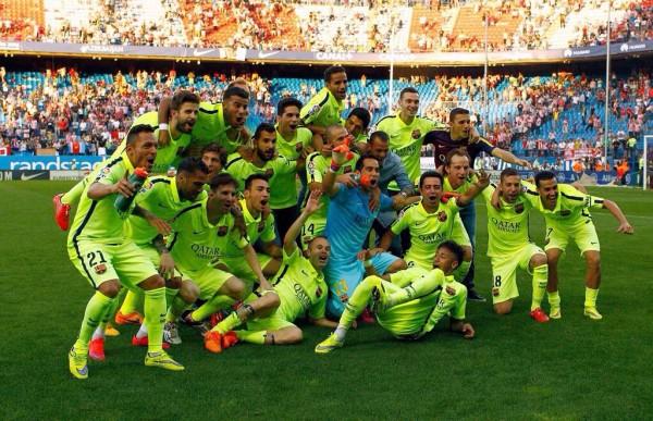 Barcelona Players Celebrate La Liga Triumph at the Vicente Calderon. Image: AFP.