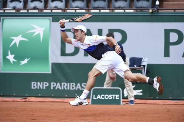 Kei Nishikori Returns a Serve against Bellucci at the Philippe-Chatrier on Wednesday. Image: Getty.