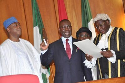 CLERK TO THE NATIONAL ASSEMBLY, SALISU MAIKASUWA (R) SWEARINNG-IN THE DEPUTY SENATE PRESIDENT, IKE EKWEREMADU AT THE INAUGURATION OF THE 8TH NATIONAL ASSEMBLY IN ABUJA ON TUESDAY (9/6/15).WITH THEM  IS SENATE PRESIDENT BUKOLA SARAKI. (NAN)