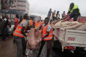 Ghana gas station explosion victims carried being carried away in body bags