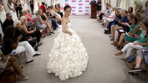 A model walks the runway wearing 'Garden Party' a design by Carol Touchstone during the 11th annual toilet paper wedding dress contest at Kleinfled's Bridal Boutique in New York June 17, 2015. The contestants competed in the annual Toilet Paper Wedding Dress Contest, showing off their dress-making skills using only Charmin toilet paper, glue, tape, Needle and thread, for the $10,000 cash prize. REUTERS/Brendan McDermid