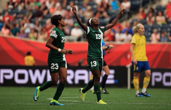 Ngozi Okobi Celebrates after Halving Nigeria's Deficit against Sweden. Image: Fifa via Getty.