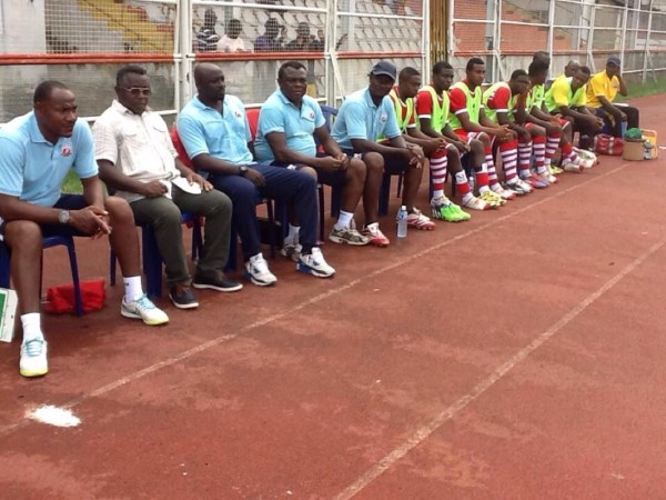 Coach Erasmus Onuh (2nd from Right) Watches On During a Glo Premier League Game. Image: Twitter @HeartlandFC_ng.