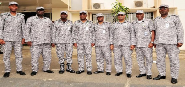 PIC. 11. COMPTROLLER-GENERAL OF CUSTOMS, DIKKO ABDULLAHI (4TH L) WITH SOME MEMBERS OF  CUSTOMS   MANAGEMENT, UNVEILING THE NEW  CAMOUFLAGE UNIFORM IN ABUJA ON WEDNESDAY (9/7/14). 3286/9/7/14/JAU/AIN/NAN