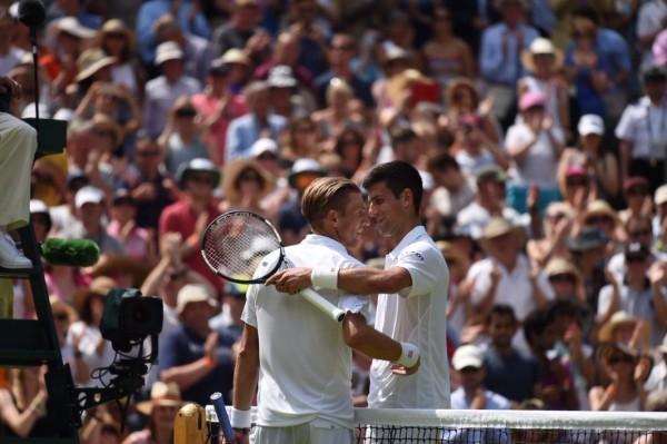 Novak Djokovic Congratulates Jarkko Nieminen On His Wimbledon Career. Image: AELTC.