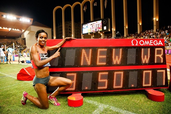 Genzebe Dibaba Poses With Her World Record Time Over 1500m in Monaco. Image: Getty via IAAF.