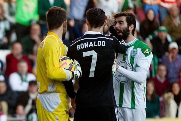 Jose Angel Crespo Appears to be Punched by Cristiano Ronaldo During One of Real Madrid and Córdoba Clash Last Season. Image: AFP.