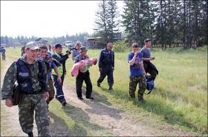 inside rescuers walk along a village