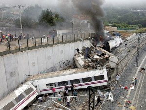 In this photo taken on Wednesday July 24 2013, Emergency personnel respond to the scene of a train derailment in Santiago de Compostela, Spain. Police say they have detained the driver of a train that crashed in northwestern Spain and killed 78 people. Galicia region National Police Chief Jaime Iglesias says driver Francisco Jose Garzon Amo was officially detained in the hospital where is recovering. (AP Photo/La Voz de Galicia/Monica Ferreiros)