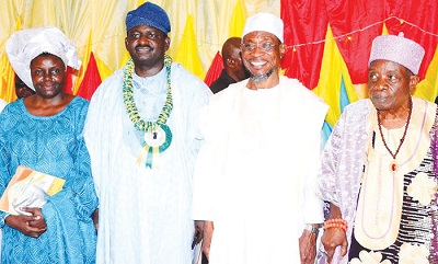 AREGBESOLA (SECOND RIGHT); ADESINA, (SECOND LEFT), HIS WIFE ADENIKE (LEFT) AND OBA AKUNRALEDOYE DURING THE RECEPTION FOR THE PRESIDENTIAL SPOKESMAN.