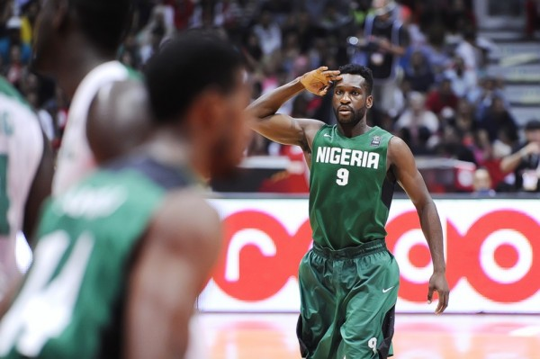 Chamberlain Oguchi Does His Famous Three-Point Salute Pose During the 2015 Afrobasket in Rades, Tunisia. Image: FIBA.